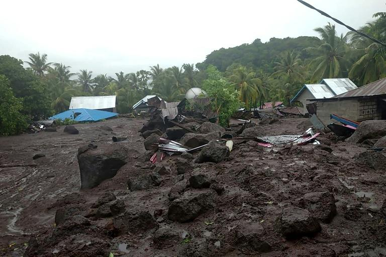 Indonesia flash floods kill 23, leave two missing