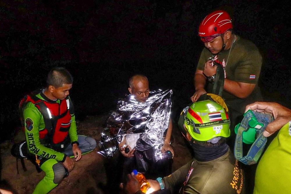 Meditating monk rescued from flooded cave in Thailand