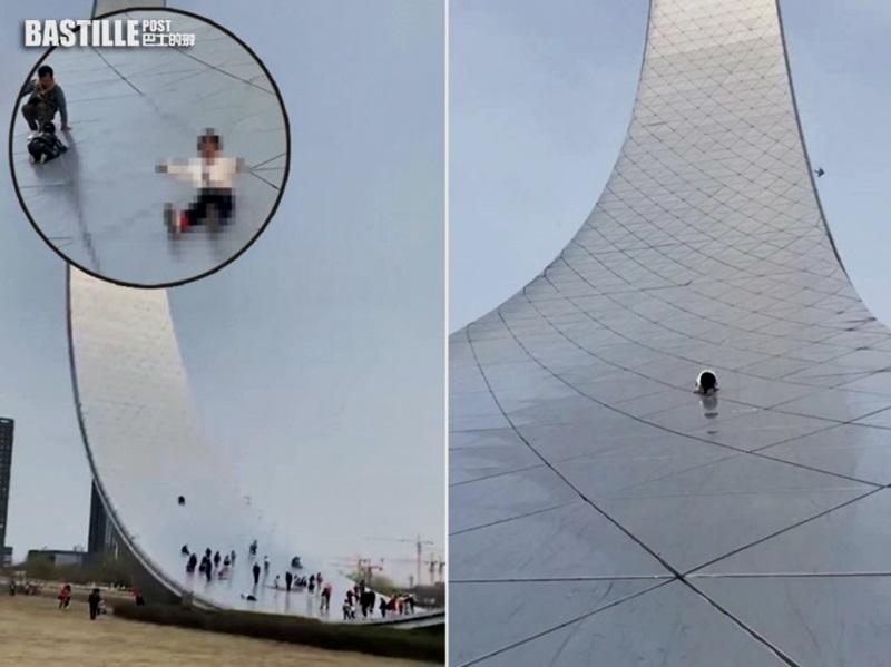 险象环生 小孩爬上地标建筑当滑梯