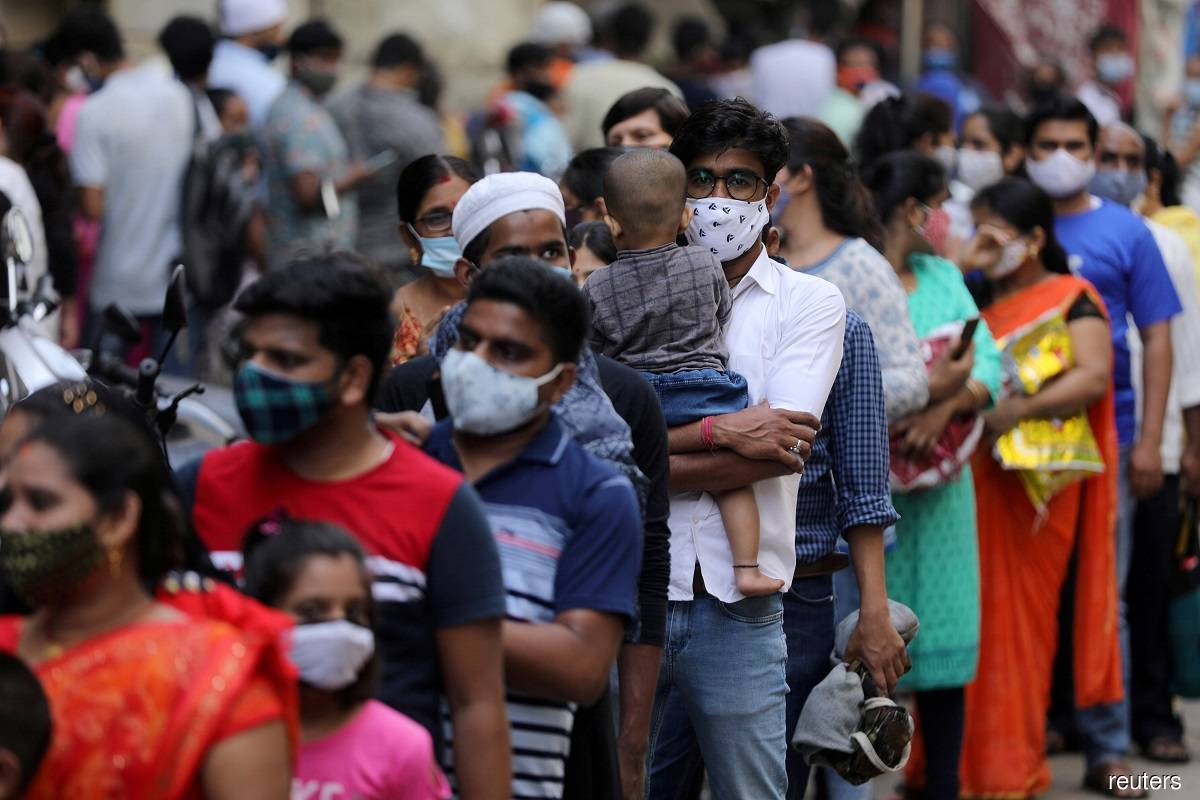 India's coronavirus cases hit record as Mumbai prepares for new lockdown