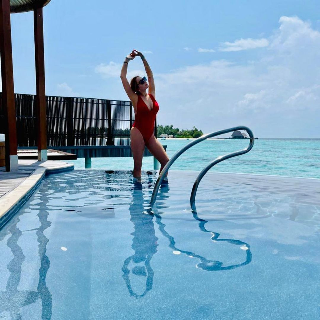Lindsay Lohan Shows Off Her Curves in a Plunging Red Swimsuit in the Maldives