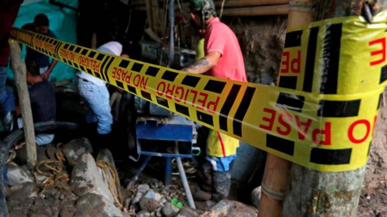 Rescuers recover bodies of 11 killed in illegal Colombian mine