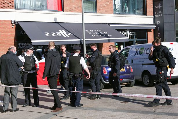 Boy, 14, stabbed to death in attack outside pizza shop as police launch murder probe