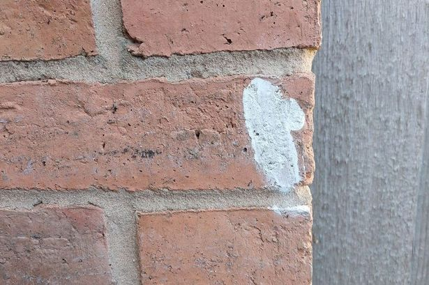 Residents 'petrified' as mysterious chalk markings appear on homes across town