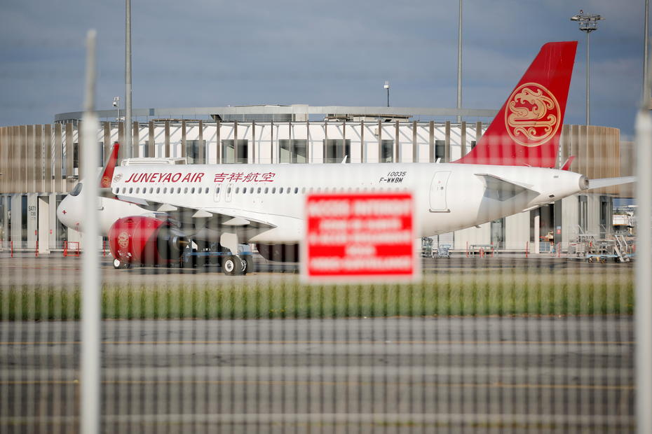 China's Juneyao Air setting up firm to invest in HNA airline assets - Caixin