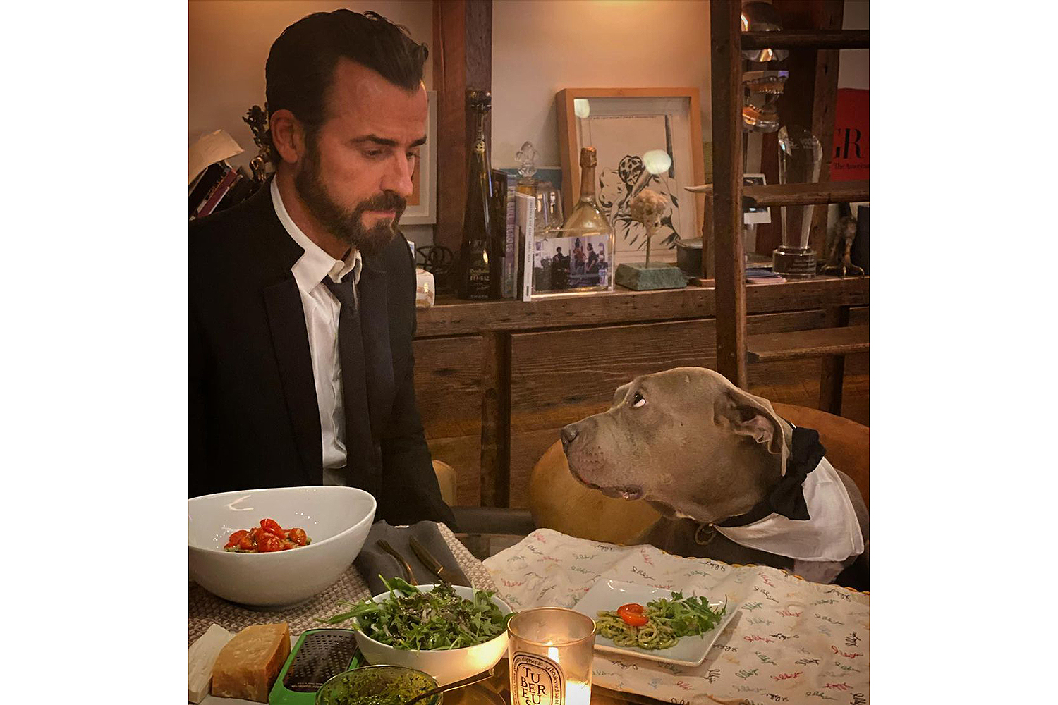 Justin Theroux Explains His 'Formal Friday' Dinners with His Dog Kuma: 'What Else Was I Doing?'