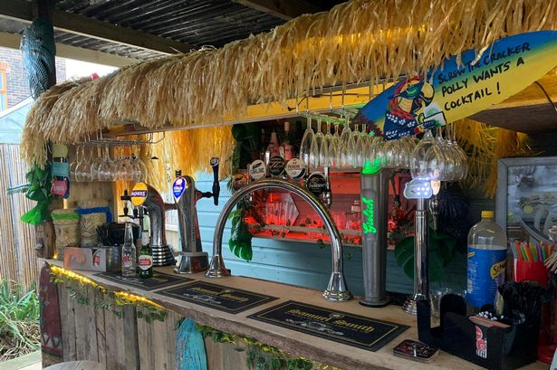 Savvy dad transforms unused garden into exotic Tiki bar - and it cost just £800