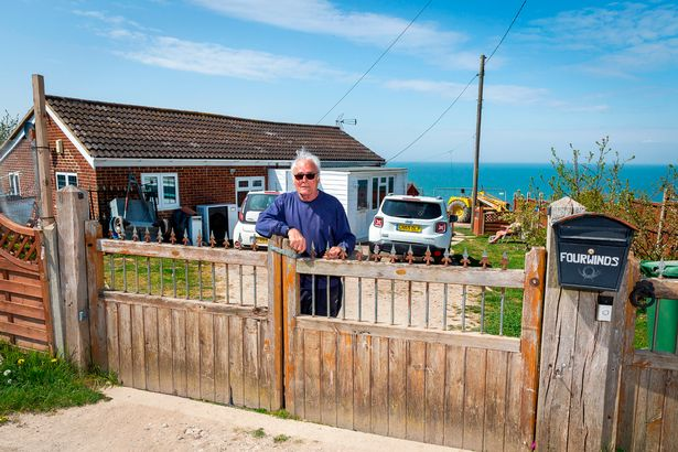 Agonising battle to save dream homes after property plunges from 120ft crumbling cliff