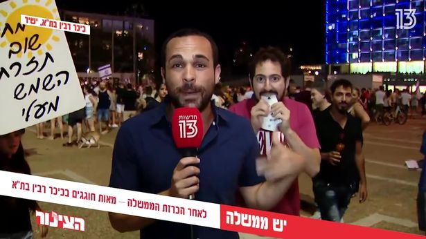 Man seizes moment to perform incredible magic act in background of live news report