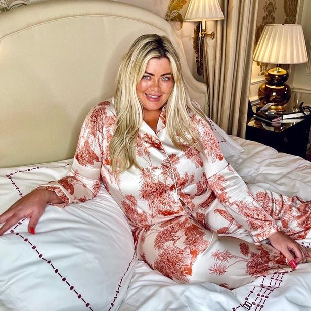 Gemma Collins goes make-up free as she lounges on a bed in silky pyjamas