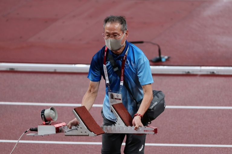 Faster, higher, older: pensioners defy virus fears to keep Tokyo Olympics running
