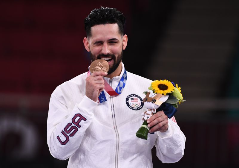 Olympics-Karate-From rags-to-medal, Torres dedicates win to immigrant parents