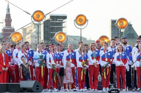 Olympics-Russia welcomes medallists home with Red Square festivities
