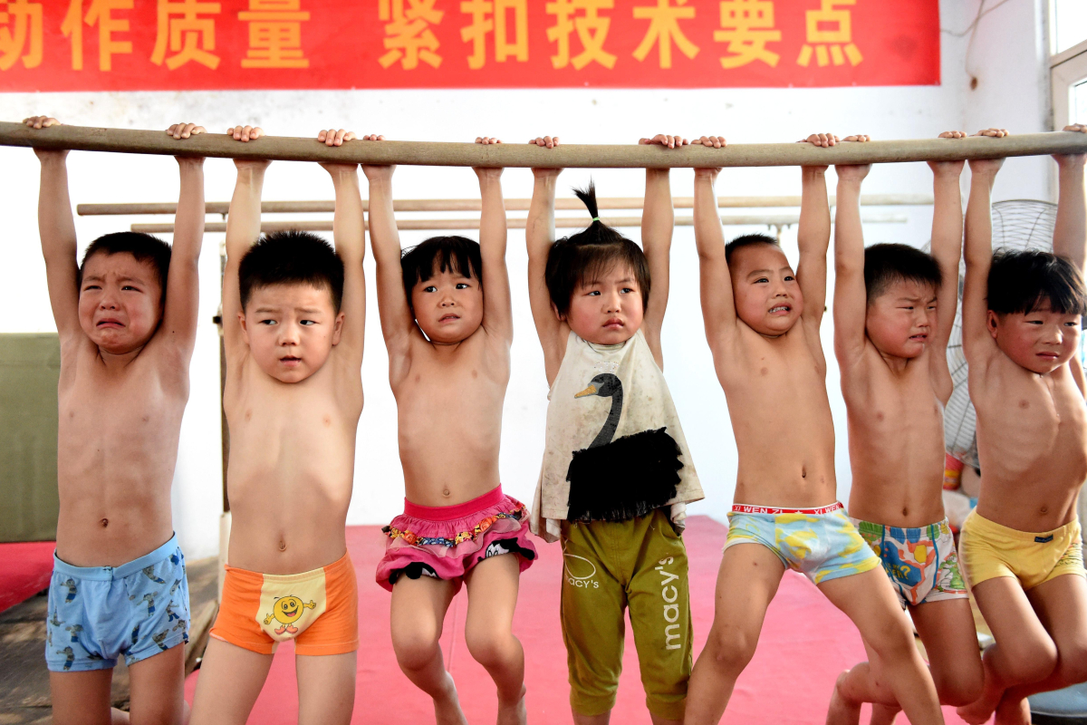 Inside China's 'gold at any cost' Olympics machine with kids as young as 4 brutalised in training…that stil...