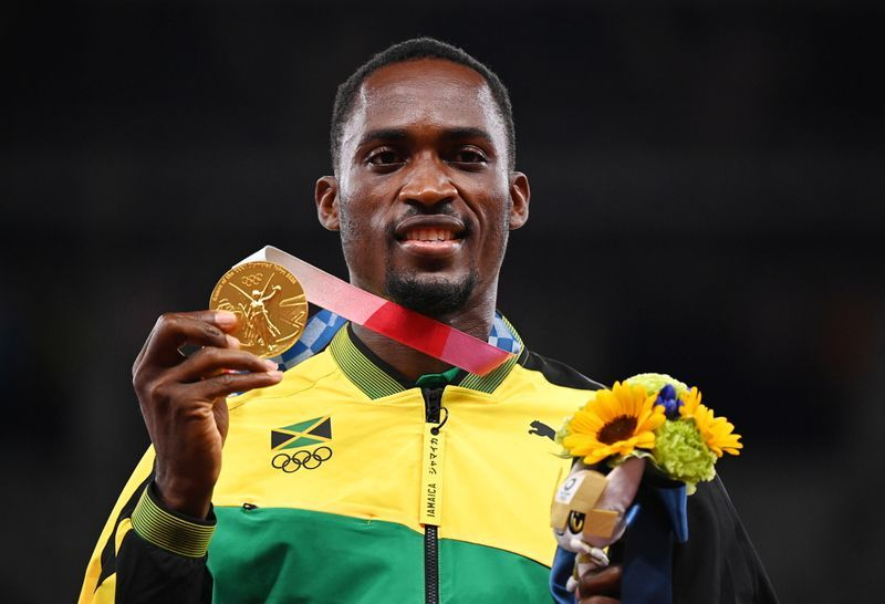 Olympics-Jamaican Parchment tracks down volunteer who helped him win gold