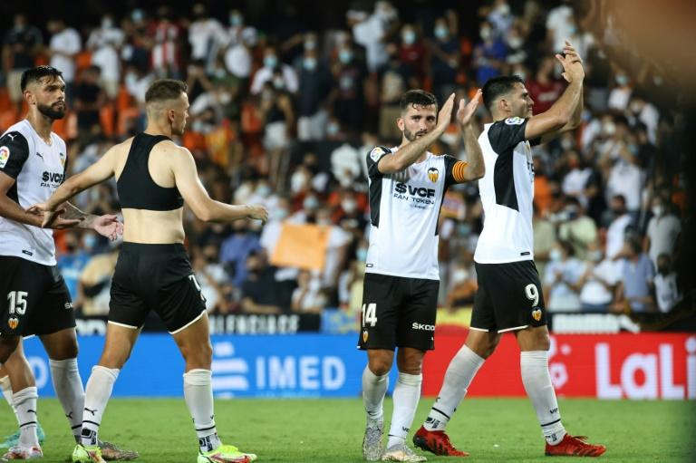 Valencia overcome third-minute red card to beat Getafe in season-opener