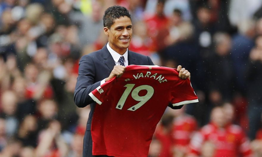 Football: Raphael Varane paraded at Old Trafford after signing 4-year deal at Manchester United