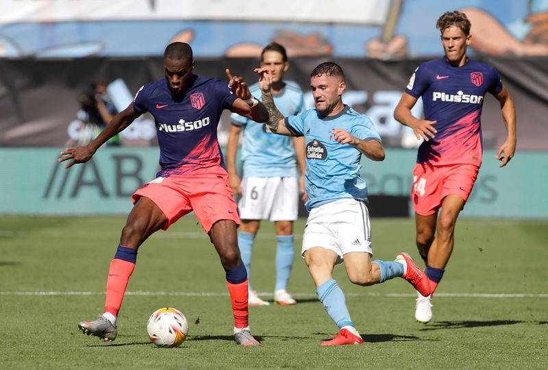 Soccer-Champions Atletico beat Celta in LaLiga opener as both sides see red