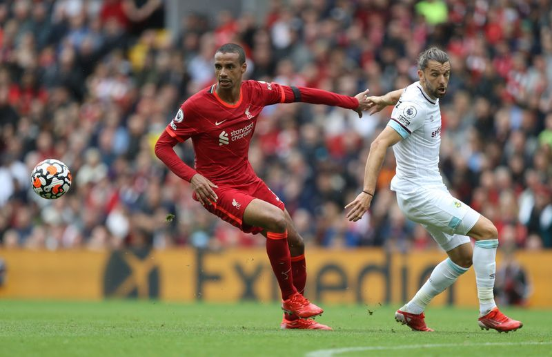 Soccer-Liverpool cruise past Burnley to make it two wins from two