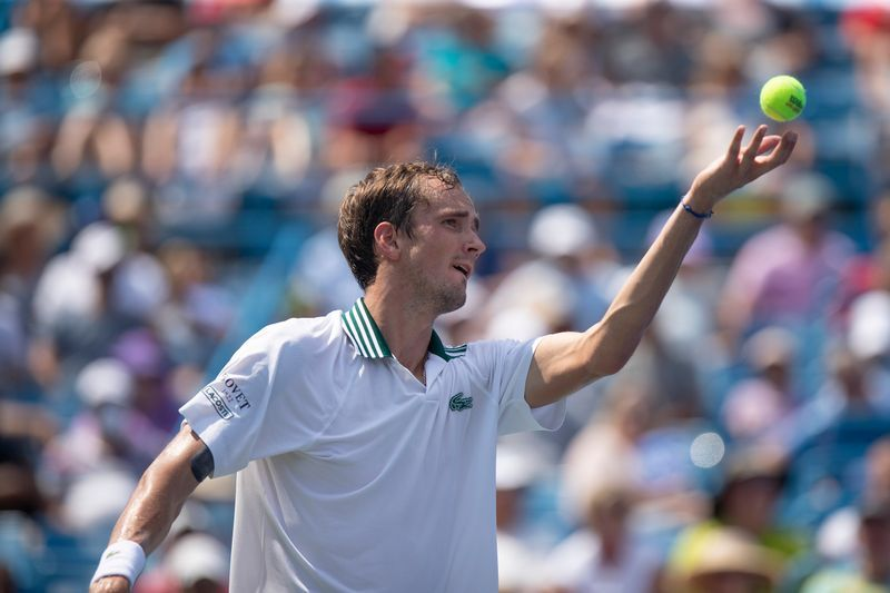 Tennis-'I almost broke my hand' Medvedev collides with camera in shock loss