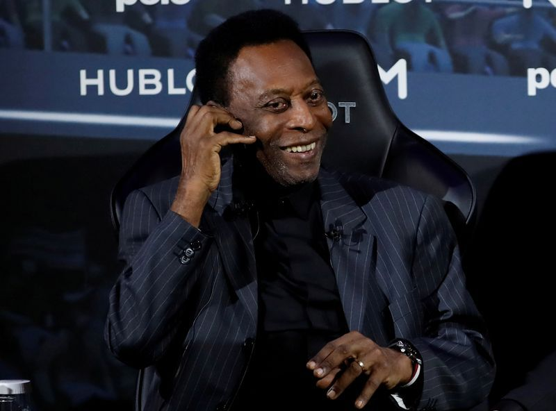 Soccer-Pele brings sporting stars together for charity auction