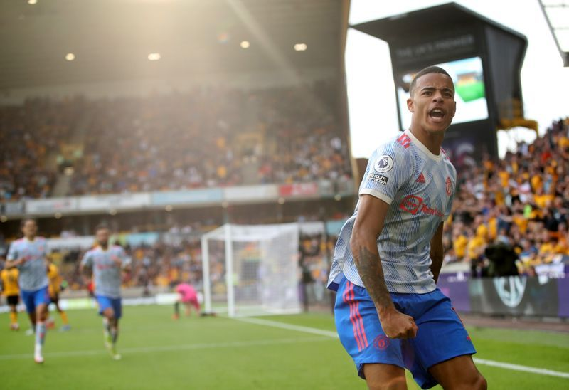 Soccer-Man United's Greenwood snatches late win at wasteful Wolves