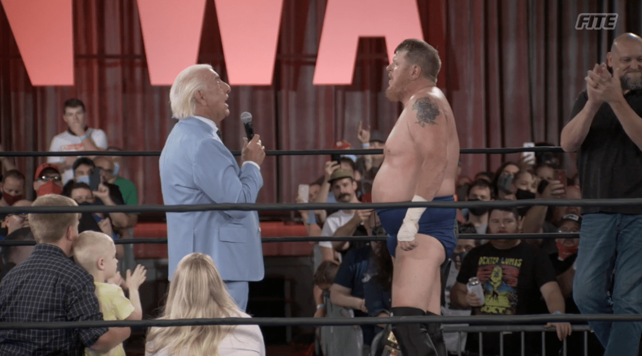 NWA 73: Trevor Murdoch celebrates with WWE legend Ric Flair after ending Nick Aldis' four-year title reign