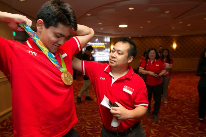 Singapore Olympian Joseph Schooling's ex-spokesman charged with 21 counts of cheating