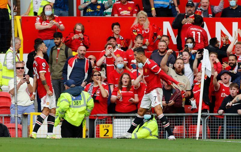 Soccer-Ronaldo debut double as Man Utd thrash Newcastle to go top
