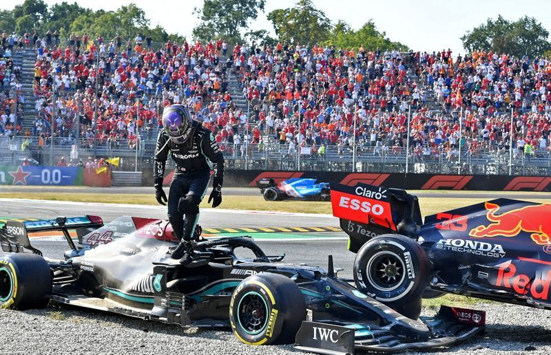 Motor racing-Verstappen penalised for crash, Hamilton saved by halo